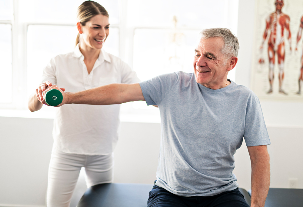 Picture of senior man and therapist physical rehabilitation